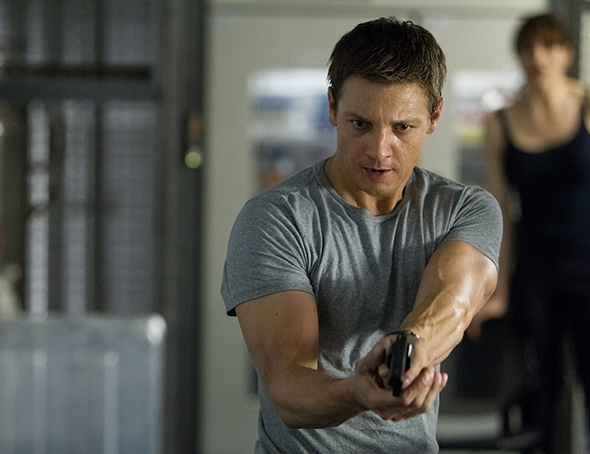 Still from The Bourne Legacy showing Aaron protecting Marta in her house
