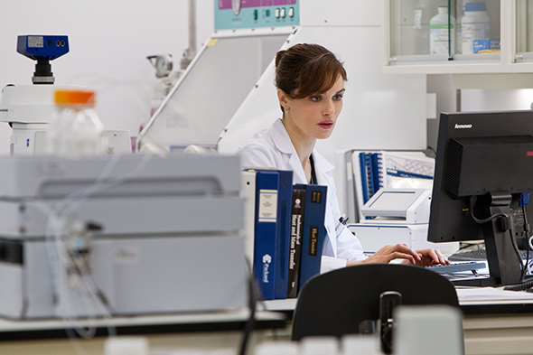 Still from The Bourne Legacy showing Rachel Weisz in the lab